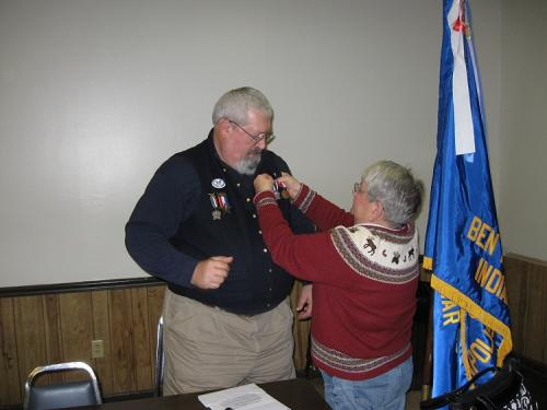 New Camp Commander John Bowyer. Commander badge pinning by his wife, Amy, ASUVCW. 12/09/12